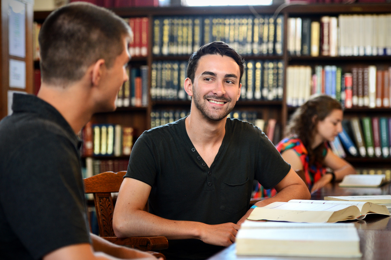 student in library in-line